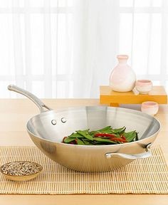 Wok and roll your way to heavenly stir-fry dishes with this amazing flat bottom wok. Versatile and strong, it features a three ply 18/10 stainless steel interior and exterior surrounded by a highly-co