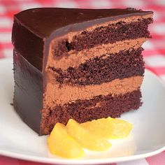 Chocolate Orange Truffle Cake with Chocolate Cointreau Glaze - classic chocolate orange flavor in a decadent dessert that's probably easier to make than you think. A perfect celebration cake, especially at the Holidays!
