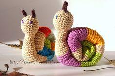 Handmade crochet knitted snails. Cotton yarn, wooden bead in the head