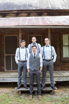 Groomsmen attire, suspenders, gray trousers, navy-blue bowties, rustic wedding // Claire Diana Photography