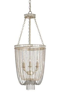 Blushing pearls add softness and delicacy to the many small chains that decorate the Socialite Chandelier. The Silver Leaf finish reflects a rosy glow, while Antique Mirror accents add an heirloom qua