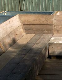 Raised bed with built-in seat from recycled scaffolding boards