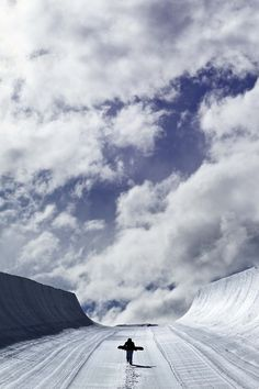 Snowboarder walking up a halfpipe