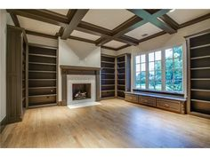 Home library // Fireplace // Beams // Built-ins