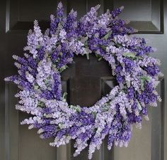 Light & dark purple flowers makes a gorgeous wreath.
