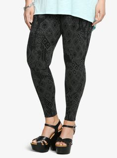 You're sure to be one cool cat in this look! This black and grey legging combines a modern textile print with edgy skulls. It's the perfect mix of contemporary, casual that lets you get comfortable in style.