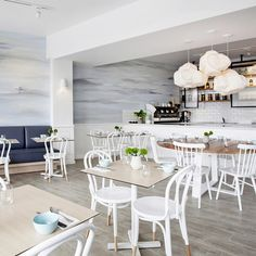 Tall diners will literally have their heads in the clouds, as Pollock has extended the mural into three dimensions with sculptural cumulus light fittings. The fresh white continues in chairs, tiling and panel paintwork, with colour introduced via the wooden tabletops and deep blue banquette...