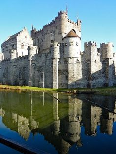 Reflection of the Gravensteen Castle. It was built in 1180 by Count Philip of Alsace and was modeled after the crusaders castles that Philip of Alsace encountered while he participated in the second crusade. In 1885 the city of Ghent bought the castle and started a renovation project. The castle was restored initially in 1893. The newly built houses were removed and the walls and keep were restored to their original condition.