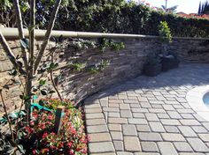 Pavers and stone veneer planter at a peaceful home in Fullerton, Ca