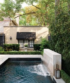 Sheer falls into dark bottom pool. This shape pool would be easy to have an automatically retractable cover.