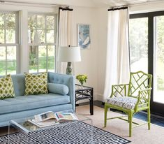 Classics are great, especially when they are updated with bright colors like this blue chesterfield sofa and lime green bamboo side chair.