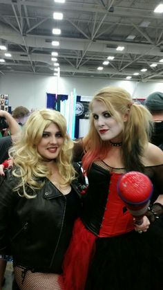 """You're up next!"" Black Canary and Harley Quinn (Pinterest pinner: DarkPhoenix) cosplay at Dallas Comic Con 2014"