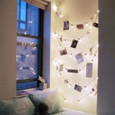 christmas lights + clothes-pinned pics