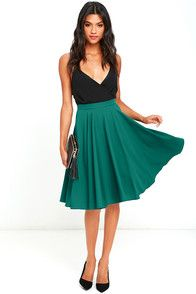 Feel as elegant as ever with every spin you take in the Dance Montage Dark Green Midi Skirt! This classic high-waisted midi skirt (made from light woven fabric), has a full circle hem. Hidden back zipper with clasp.