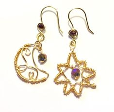 Gold Mismatched Moon and Star Earrings gold wire wrapped with dangling purple rondelle bead Wire Wrapped Jewelry, Wire Jewelry, Jewellery, Moon And Star Earrings, Gold Earrings, Drop Earrings, Gold Wire, Wire Wrapping, Earring Set