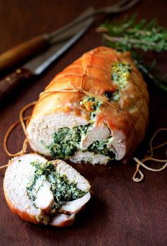 Find Spinach and Ricotta Stuffed Turkey Breast with Garlic and Herb Sauce and other simply great recipes at From a Chef's Kitchen