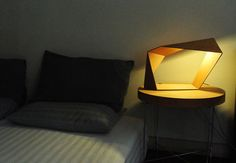 Wood lamps that fold like origami by Anurak Suchat