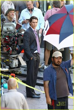Christian Bale looking dapper behind the scenes on The Dark Knight Rises