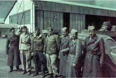 "A group of II.Gruppe / Jagdgeschwader 2 (JG 2) ""Richthofen"" personnel in Tunisia, early 1943. Third from the left is Oberleutnant Erich Rudorffer (temporary Gruppenkommandeur of II./JG 2), who ended the war as a Major with 224 victories and the recipient of Ritterkreuz des Eisernen Kreuzes mit Eichenlaub und Schwertern."