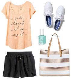 Black pants, orange graphic tee, white shoes, mint nail  polish