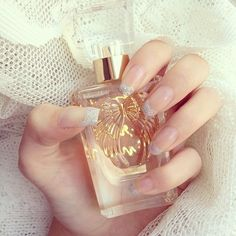 Gold perfume bottle & silver sparkle french manicure