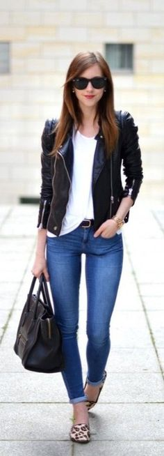 Here's 15 great ways to wear a black leather jacket! From layering over basics to colorblocking with colored leather, you can't go wrong with a staple leather jacket! What's your favorite way to style a leather jacket?