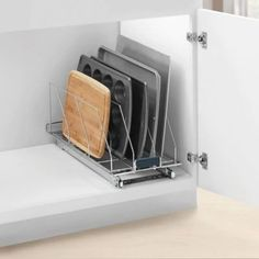 Organize all of your heavy, bulky cutting boards, and tall trays with the handy Bakeware Pullout Rack from Real Simple. Featuring a generous size, this rack simply slides to the front of your cabinet for easy selection and features useful dividers.