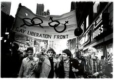 Immediately after the Stonewall riots, the Gay Liberation Front was founded to advocate for gay rights. Here, in the fall of 1969, young members of the GLF march through Times Square.  Source: New York Public Library