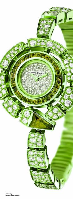 Green - BULGARI Serpenti Incantati watch - origina gold with diamonds and rubellites - http://www.thejewelleryeditor.com/