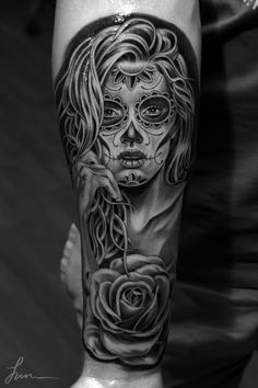 impressive black and grey Living Dead Girl tattoo done by the LA-based artist Jun Cha.