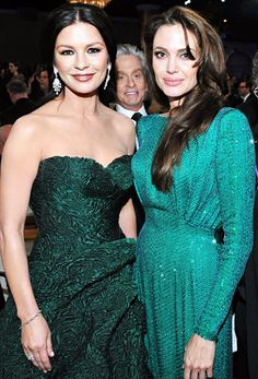 Catherine Zeta-Jones and Angelina Jolie are glamorous in green. #celebstylewed #coloroftheyear #emerald
