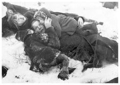 In Helsinki, a Finnish mother shelters her children during a Soviet air raid, on 31 Dec 1939. The USSR invaded Finland a month prior, but the Finns inflicted grievous casualties and crippled the Red Army's advance.