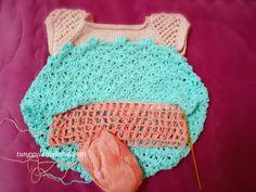 My crochet - baby dress in progress.