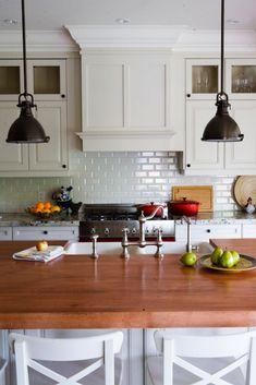 Gorgeous kitchen design with white kitchen cabinets & kitchen island, butcher block counter tops