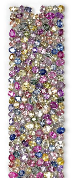 A multi-color sapphire and diamond wide bracelet composed of various-shaped multi-color sapphires with interspersed rose-cut diamonds; estimated total colored sapphire weight: 182.00 carats; estimated total diamond weight: 2.00 carats / Bonhams