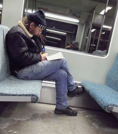 Beer drinking reader in Berlin metro