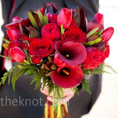 I love these red flowers. Add some taupe, orange, and a chocolate brown ribbon and they'd be perfect.
