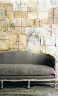 The vintage drawings of street lights make such amazing wallpaper! The grey tones of the illustrations are the perfect accent for the gray sofa.