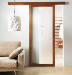 elegantes-Wohnzimmer-minimalistische-Einrichtung-Schiebetür-mattes-Glas-Raumteiler