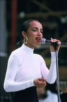 Sade-Had to repin this, grew up listening to her :) Thanks to me Mum :)
