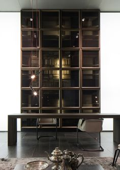 Q-Case, #Design Massimo Castagna -   Bookshelf-sideboard system, structure in thermo american oak and doors in solid thermo american oak frame and laminated glass with crumpled burnished steel tissue blue noir, internal structure in black thermo eucalyptus, back structure in leather.
