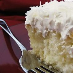 """Coconut Poke Cake   """"This cake tastes great and is so easy. I also could only find coconut milk. I did as one of the reviewers recommended and mixed in 4 T. of cornstarch with the coconut milk and sweetened condensed milk. Worked great! I would highly recommend this recipe as a quick cake that tastes delicious!"""""""