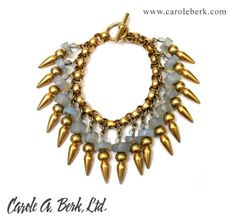 Robert Lee Morris 90's design for Donna Karan-  African blue glass and  gold plated brass spikey bracelet ,$445. Earrings available to match