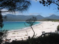 The white sand and clear blue water of Wineglass Bay, Freycinet National Park on the east coast of #Tasmania #Australia.