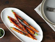 Chopping the mustard greens and sprinkling them over the carrots as a gremolata is a unique way to optimize their bright and intense flavor.