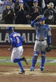 Kansas City Royals catcher Salvador Perez stands by while New York Mets right fielder Curtis Granderson scores on a solo homerun in the first inning during game five of the World Series on Sunday, November 1, 2015 at Citi Field in New York.
