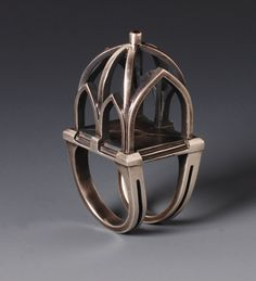 Ring | Donna Veverka.  Hand carved, cast and fabricated sterling silver with garnet.