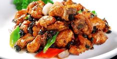 The chicken with black bean is a famous dish of Han nationality, which has a complete color, fragrance and belongs to Cantonese cuisine. Marinated Chicken, Tandoori Chicken, Cantonese Cuisine, Black Bean Chicken, Best Chinese Food, Black Beans, Stir Fry, Food Print, Spicy