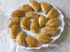 tee- row -pee-ta) (τυρóπιτα), from tyri (cheese) + pita = pie is a Greek pastry made with different cheese fillings. Greek Pastries, Greek Recipes, Pretzel Bites, Street Food, Cl, Hospitality, Friday, Cheese, Greek Food Recipes