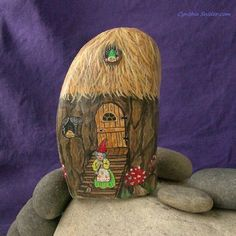 Rock Gnome House #paintedrock #garden gnome #handpainted #rockpainting #gnomestone #Estyshop#cynthiasnider #nightowlfineart #artist NightOwlFineArt-onEtsy https://www.etsy.com/ca/listing/487792210/painted-rockpainted-stonegnome-houserock